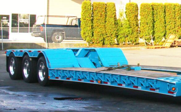 Widen device on low loader trailer